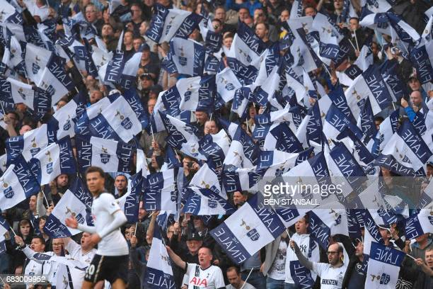 Fans hold up special 'Finale' flags in the crowd during the English Premier League football match between Tottenham Hotspur and Manchester United at...