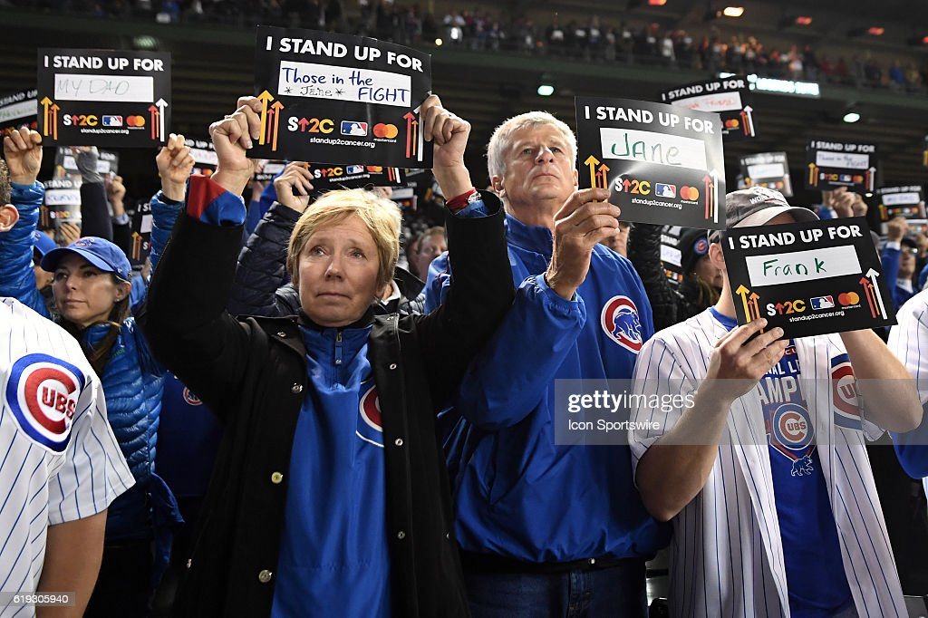 Fans hold up Stand Up To Cancer signs during the 2016 World Series Game 4 between the Cleveland Indians and the Chicago Cubs on October 29, 2016, at the Wrigley Field in Chicago, IL.
