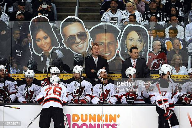 Fans hold up the heads of the cast of the MTV reality show Jersey Shoe behind the bench of the New Jersey Devils during the game against the Los...