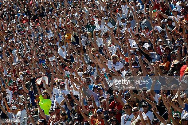 Fans hold up three fingers during lap three a lap of silence in honor of Dale Earnhardt who died on the final lap of the 2001 Daytona 500 during the...