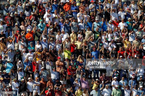 Fans hold up three fingers during the lap of silence in honor of Dale Earnhardt who died on the final lap of the 2001 Daytona 500 in the NASCAR...