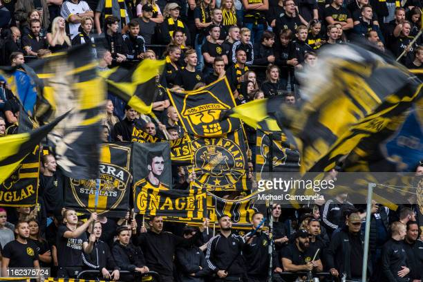 Fans holding scarves and waving flags during an Allsvenskan match between AIK and Kalmar FF at Friends Arena on August 18 2019 in Stockholm Sweden