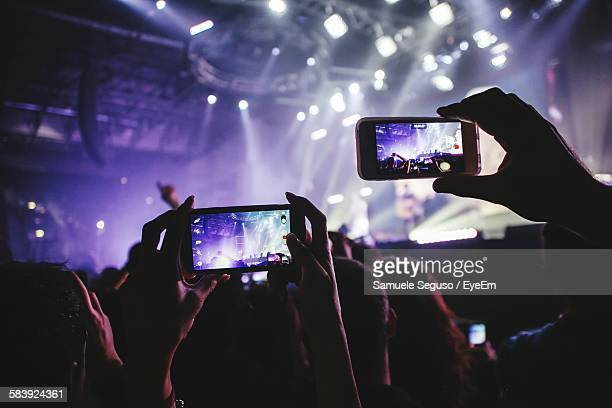 Fans Holding Smart Phones At Musical Concert