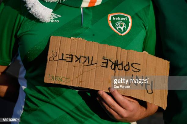 A fans holds a sign requesting 'spare tickets' prior to the FIFA 2018 World Cup Group D Qualifier between Wales and Republic of Ireland at the...