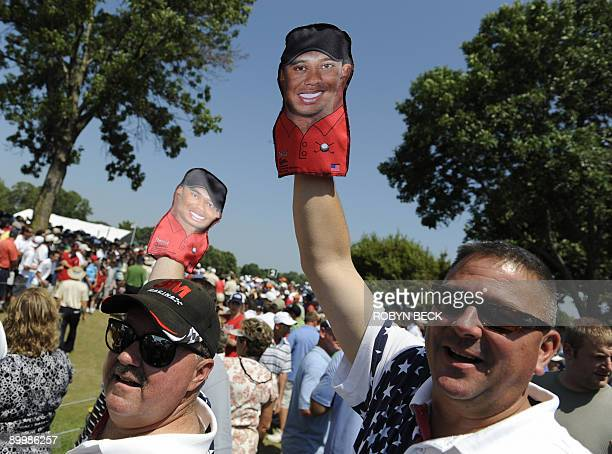 Fans holds Tiger Woods puppets as they wait to see Woods on the course during the second round of the 91st PGA Championship at the Hazeltine National...