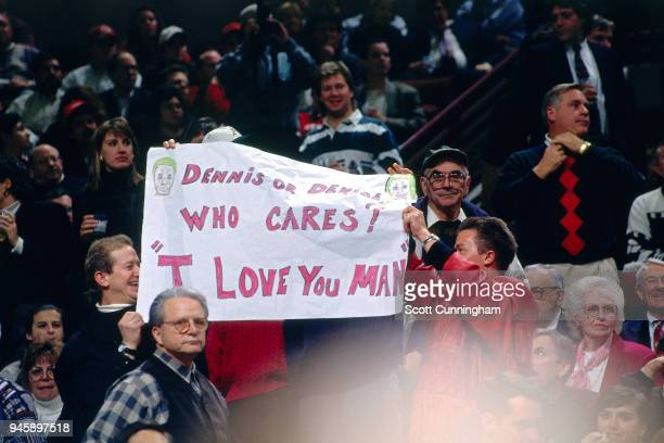 Fans holds up a sign during the game between the New York Knicks and the Chicago Bulls on December 6 1995 at the United Center in Chicago Illiniois...
