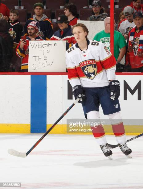 A fans holds up a sign saying welcome to the show during warmup as Henrik Borgstrom of the Florida Panthers prepares to make his NHL debut against...