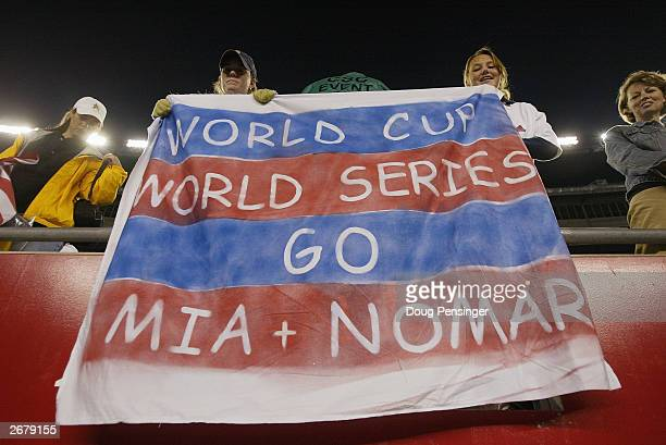 Fans hope that forward Mia Hamm of the USA wins the World Cup and her fiancee, shortstop Nomar Garciaparra of the Boston Red Sox, wins the World...