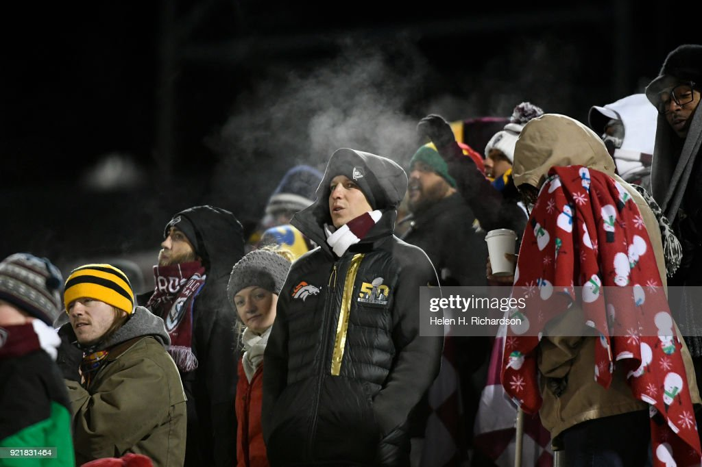 Fans huddle together in the stands as they endure sub-freezing temperatures during the game on February 20, 2018 in Commerce City, Colorado. This is the first round of 16 in the CONCACAF Champions League game at Dick's Sporting Goods Park. The Colorado Rapids take on the defending MLS Cup champs in tonight's game. The coldest game on record is 19 degrees at kickoff. Tonight's game could be much colder.