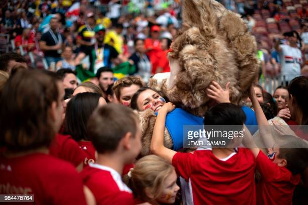 TOPSHOT Fans hug Russia 2018 World Cup mascot Zabivaka during the Russia 2018 World Cup Group C football match between Denmark and France at the...