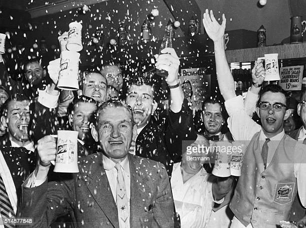 Fans in a bar celebrate the World Series victory of the 1957 Milwaukee Braves