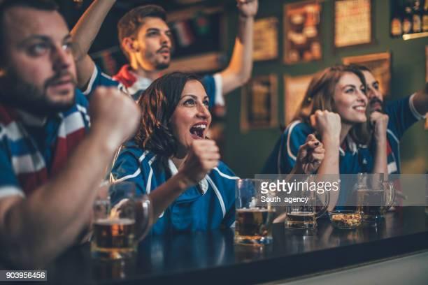 Fans in a pub