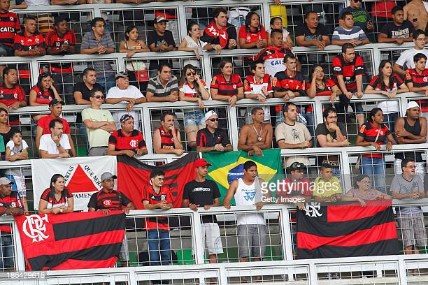 Fans in action during the match between Flamengo and Atletico Mineiro for the Brazilian Series A 2013 at Independencia Stadium on October 20 2013 in...