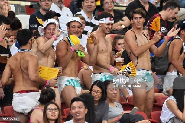 Fans in adult diapers attend the match between New Zealand and Wales during day one of the Singapore Rugby Sevens tournament in Singapore on April 15...