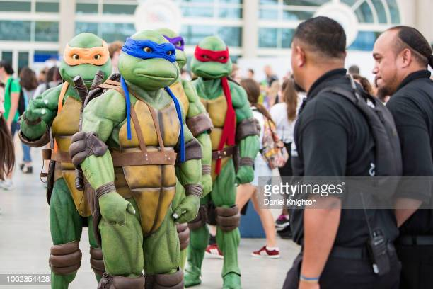 Fans in costume attend Comic-Con International on July 19, 2018 in San Diego, California.