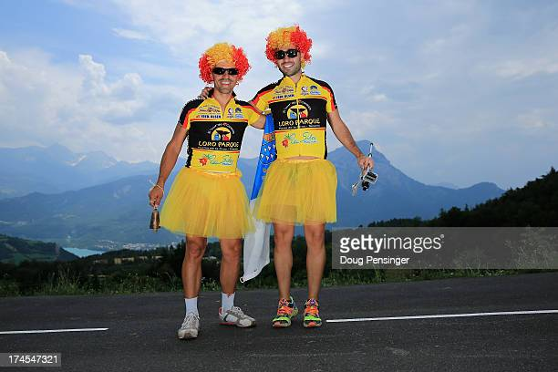 Fans in costume pose for a photo on the course during stage seventeen of the 2013 Tour de France, a 32KM Individual Time Trial from Embrun to...