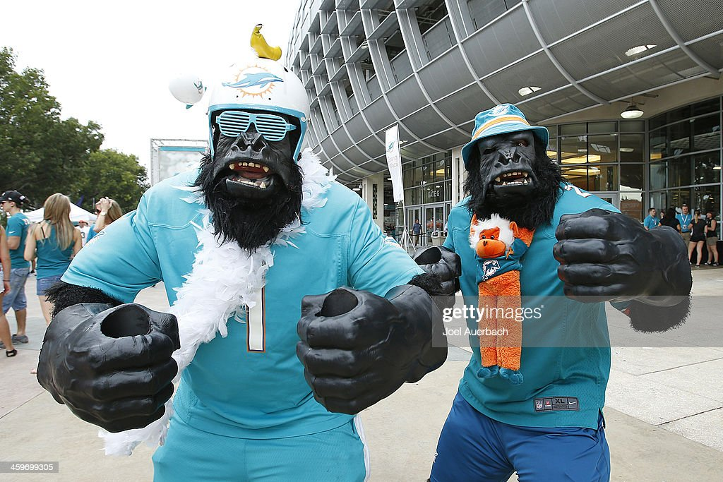 Fans in costume walk in front of Sun Life Stadium prior to the game between the Miami Dolphins and the New York Jets on December 29, 2013 in Miami Gardens, Florida.
