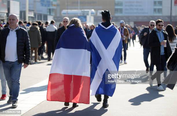 Fans in France and Scotland flags before kick off during the Guinness Six Nations match at the Stade De France Paris