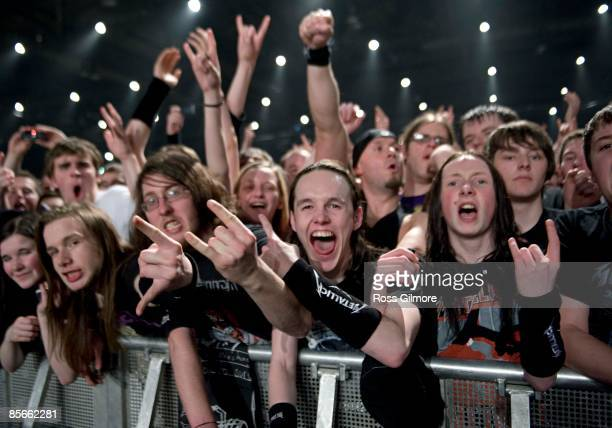 fans in front rows of audience watching Metallica play at SECC on March 26 2009 in Glasgow Scotland