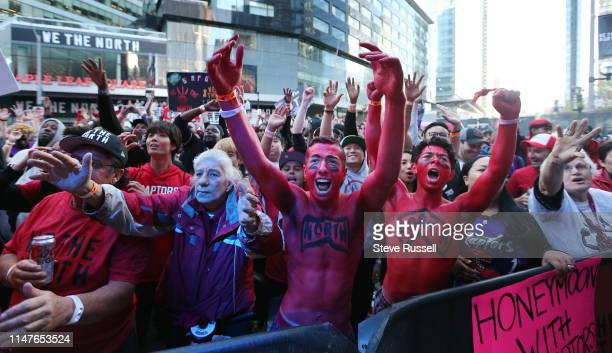 TORONTO ON JUNE 2 Fans in Jurassic Park cheer as the Toronto Raptors play the Golden State Warriors in game Two of the NBA Finals at Scotiabank Arena...