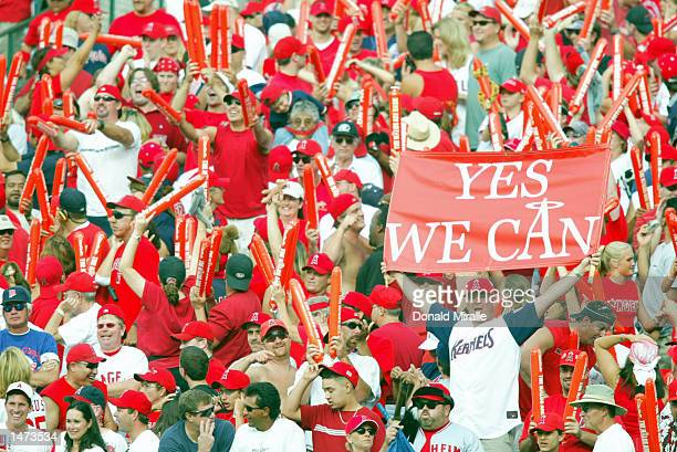 Fans in right field cheer after Adam Kennedy of the Anaheim Angels hits a three run home run, his third of the game, in the seventh inning of Game...