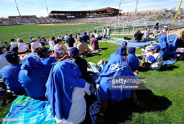 Fans in right field watch a spring training game of the Los Angeles Dodgers home opener against Chicago White Sox at Camelback Ranch March 1, 2009 in...