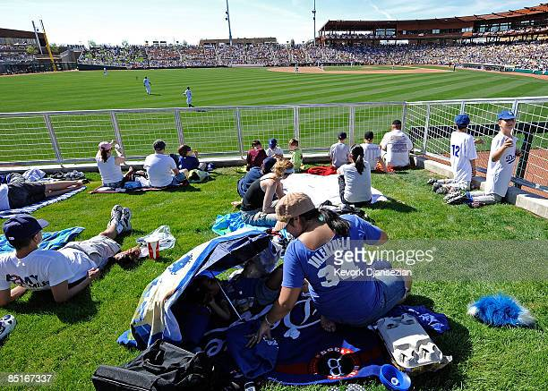 Fans in right field watch a spring training game of the Los Angeles Dodgers home opener against Chicago White Sox at Camelback Ranch March 1 2009 in...