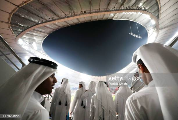 Fans in thawbs look on during day seven of 17th IAAF World Athletics Championships Doha 2019 at Khalifa International Stadium on October 03 2019 in...