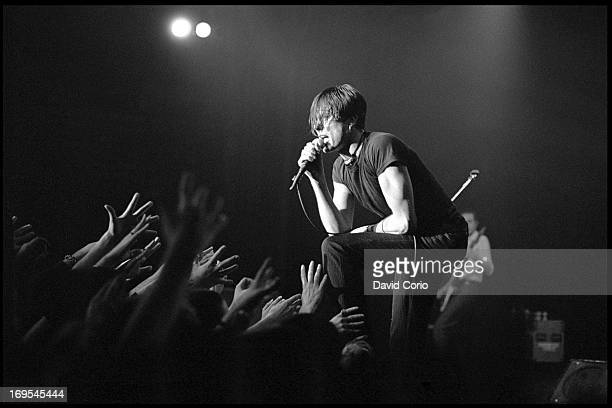 Fans in the audience reach out their hands to Brett Anderson of Suede as her performs at the Manhattan Center New York on 14 February 1995