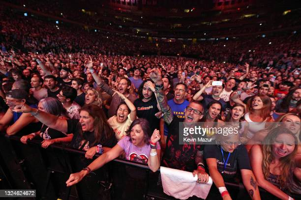 Fans in the audience react as The Foo Fighters reopen Madison Square Garden on June 20, 2021 in New York City. The concert, with all attendees...