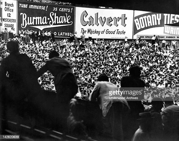 Fans in the bleachers during a baseball game at Yankee Stadium New York New York late 1930s