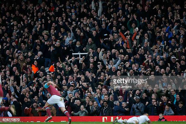 Fans in the Bobby Moore stand celebrate a goal by Andy Carroll during the West Ham United v Liverpool FA Premier League match at the Boleyn Ground on...