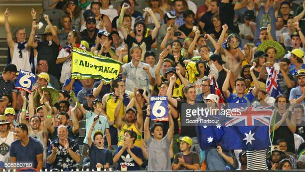 Fans in the crowd show their support after Glenn Maxwell of Australia hit a six during game three of the One Day International Series between...