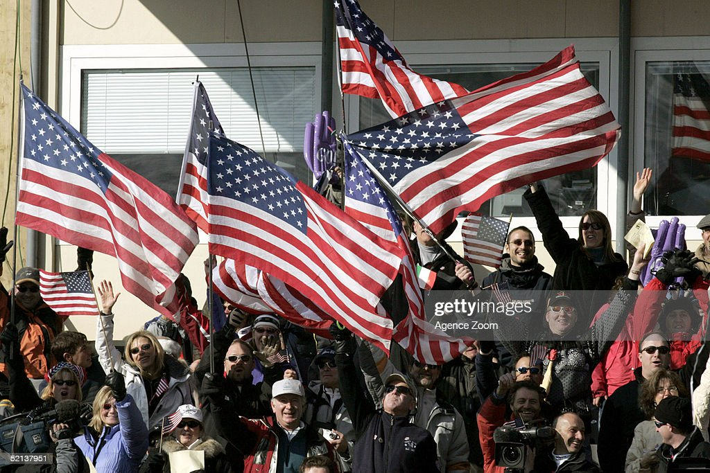 Fans in the crowd wave American Flags during the Men's Downhill at the FIS Alpine World Ski Championships 2005 on February 5, 2005 in Bormio, Italy.