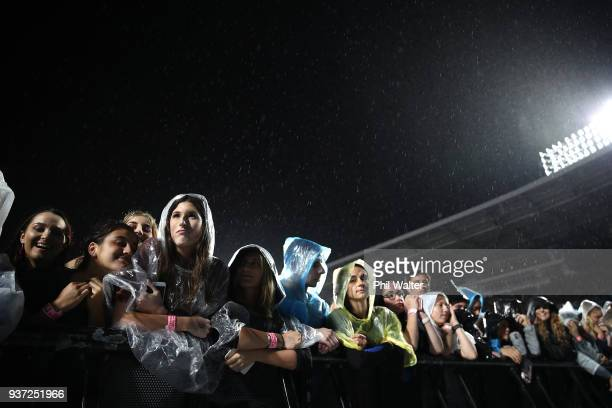 Fans in the front row wait in the rain for the Ed Sheeran concert at Mt Smart Stadium on March 24 2018 in Auckland New Zealand