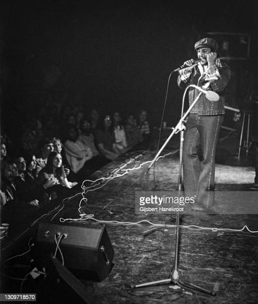 Fans in the front rows of the audience watch Royce Jones of Steely Dan perform on stage at Santa Monica Civic Auditorium, California, United States,...