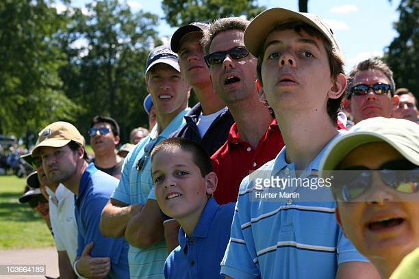 Fans in the gallery react as they watch the flight of Tigers Woods tee shot on the 15th hole during the second round of The Barclays at the Ridgewood...