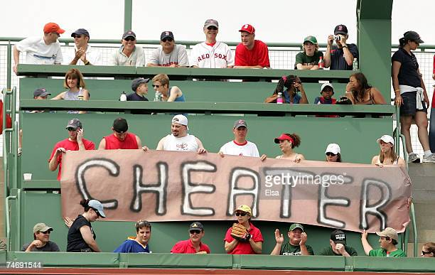 Fans in the Green Monster seats hold up a sign as Barry Bonds of the San Francisco Giants is up to bat against the Boston Red Sox on June 17, 2007 at...