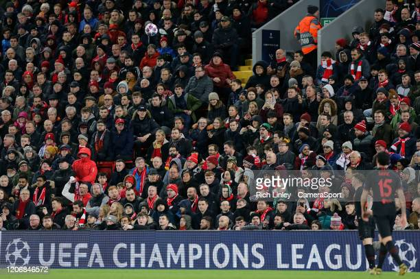 Fans in the Kenny Dalglish stand look on during the UEFA Champions League round of 16 second leg match between Liverpool FC and Atletico Madrid at...