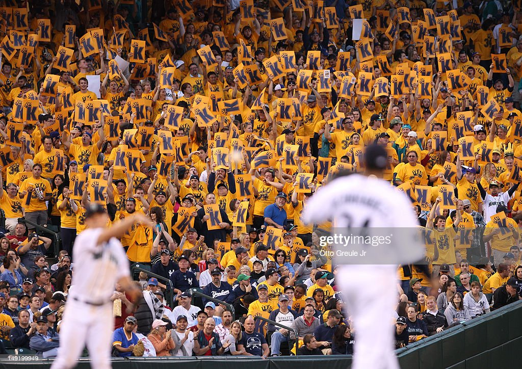 Fans in the King's Court section cheer after starting pitcher Felix Hernandez of the Seattle Mariners struck out Alex Rodriguez of the New York Yankees at Safeco Field on July 24, 2012 in Seattle, Washington. The Mariners defeated the Yankees 4-2.