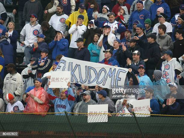 Fans in the right field bleachers cheer after Kosuke Fukudome of the Chicago Cubs hit a threerun home run in the bottom of the 9th inning against the...