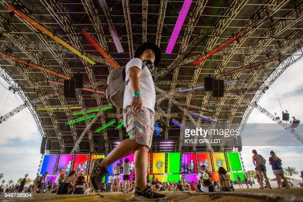 TOPSHOT Fans in the Sahara Tent look on during the Giraffage performance at the Coachella Music and Arts Festival in Indio California on April 15 2018