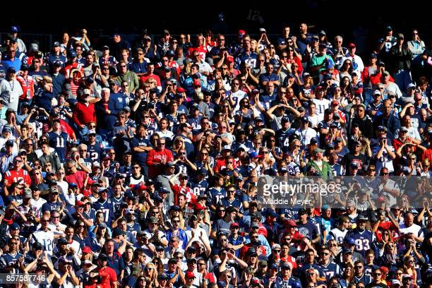 Fans in the stands during the game between the New England Patriots and the Carolina Panthers at Gillette Stadium on October 1 2017 in Foxboro...