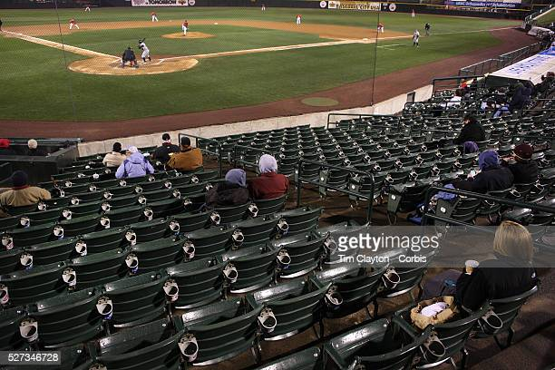 Fans in the stands on a cold and wet evening during the Rochester Red Wings V The Scranton/WilkesBarre RailRiders Minor League ball game at Frontier...