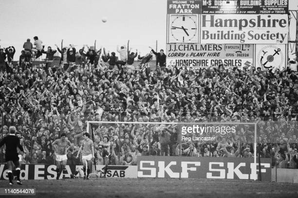 Fans in the terraces watching a Portsmouth v Southampton match at Fratton Park, Portsmouth, UK, 30th January 1984.