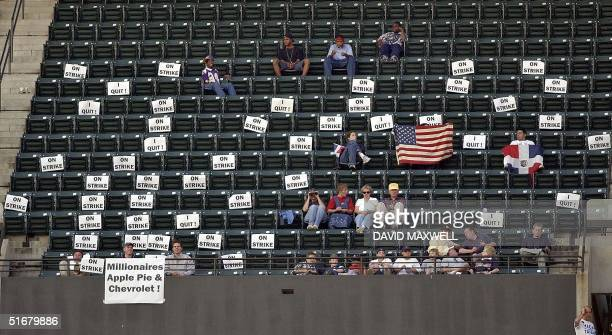 Fans in the upper deck erect an editorial sign display in empty seats during the second inning of the game between the Cleveland Indians and the...