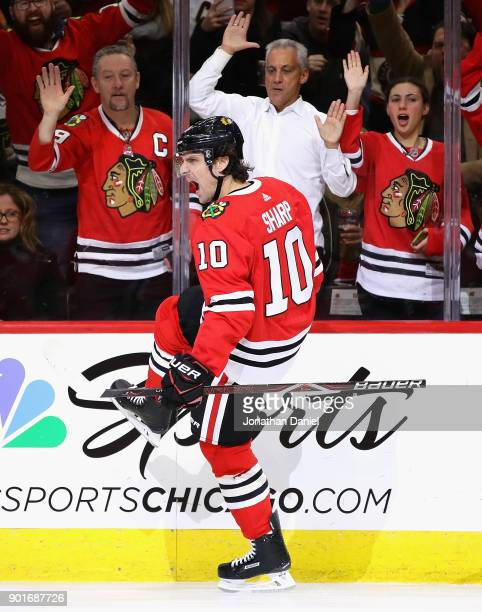 Fans including Chicago mayor Rahm Emanuel cheer as Patrick Sharp of the Chicago Blackhawks celebrates a second period goal against the Vegas Golden...