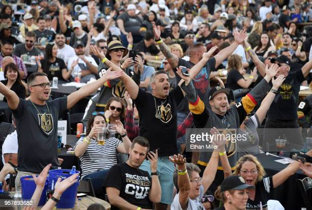 Fans including Esteban Rey of Nevada sing and dance as the Village People song YMCA is played during a Vegas Golden Knights road game watch party at...