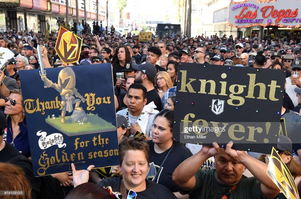 Fans, including Jeannette Hall (L) of Nevada, attend the Vegas Golden Knights' 'Stick Salute to Vegas and Our Fans' event at the Fremont Street Experience on June 13, 2018 in Las Vegas. Nevada. The Golden Knights made it to the Stanley Cup Final in the team's inaugural season, losing to the Washington Capitals four games to one in the series.