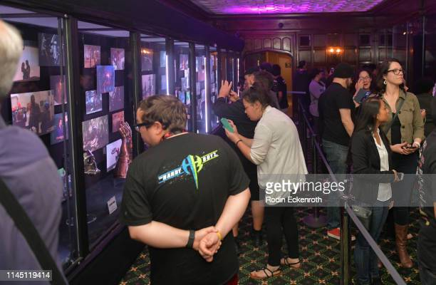 Fans inspect memorabilia from the Marvel film franchise at the Marvel Studios's Avengers Endgame opening day marathon event at El Capitan Theatre on...